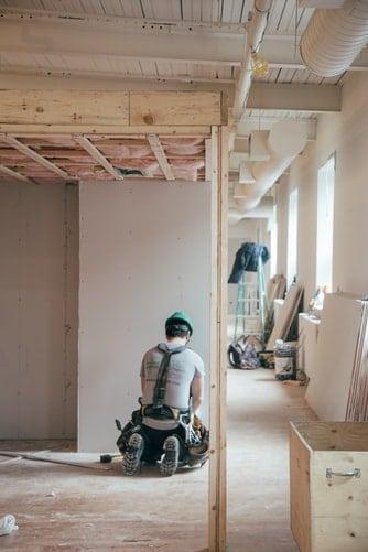 Construction worker inside a building.