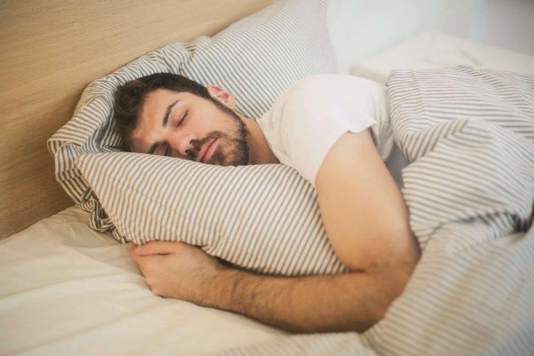 Man sleeping on bed.